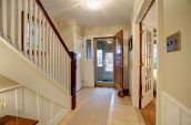 home foyer with staircase and front door