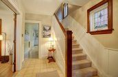 brown and white carpeted staircase photo