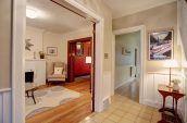 brown wooden table beside doorway