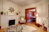brown sofa chairs beside doorway