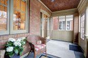 brown wicker armchair beside home front door