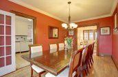 rectangular brown wooden table beside wall