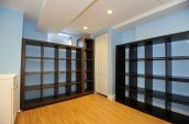 brown wooden shelf in room with blue walls