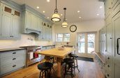 wooden kitchen with blue cabinets