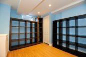 brown wooden rack in room with blue painted walls